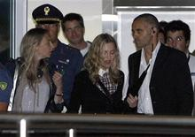 """<p>U.S. pop star Madonna (C), director of movie """"W.E"""", arrives at the Venice airport during the 68th Venice Film Festival August 31, 2011. REUTERS/Alessandro Garofalo</p>"""