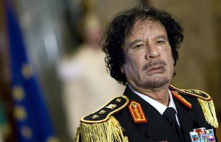 Libya's leader Muammar Gaddafi looks on during a news conference at the Quirinale palace in Rome in this June 10, 2009 file photo. REUTERS/Max Rossi/Files