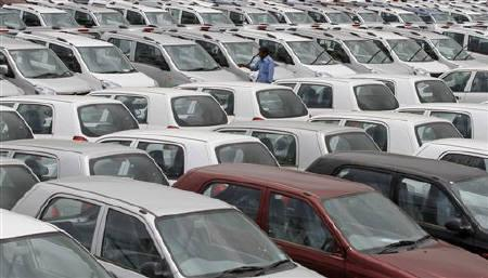 A worker walks at Maruti Suzuki stockyard on the outskirts of Ahmedabad August 1, 2011. REUTERS/Amit Dave/Files