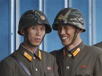 <p>North Korean soldiers talk as they patrol at the truce village of the Panmunjom in the demilitarised zone separating the two Koreas, in Paju, north of Seoul September 14, 2011. REUTERS/Lee Jae-Won</p>
