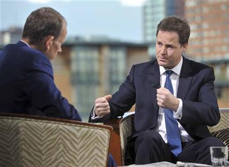 Deputy Prime Minister Nick Clegg (R) speaks on the BBC's The Andrew Marr Show, in Birmingham September 18, 2011. REUTERS/Jeff Overs/BBC/Handout