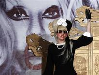 <p>U.S. singer Lady Gaga waves as she arrives for a news conference in Taipei July 4, 2011. REUTERS/Nicky Loh</p>