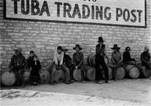 """<p>A photograph by Peter Sekaer, """"Navajos in front of sign for Tuba Trading Post, n.d."""", is seen in this handout released to Reuters by the International Center of Photography (ICP), New York on September 16, 2011. The """"Signs of Life; Photographs of Peter Sekaer,"""" which began September 9, 2011, at the ICP and runs through January 8, 2012, is the first major museum exhibit dedicated to Sekaer's work. REUTERS/International Center of Photography/Peter Sekaer Estate High Museum of Art, Atlanta, GA/Handout</p>"""
