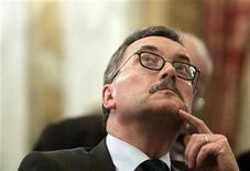 <p>Former chief economist of European Central Bank (ECB) Juergen Stark reacts during a meeting in Vienna September 15, 2011. REUTERS/Herwig Prammer</p>