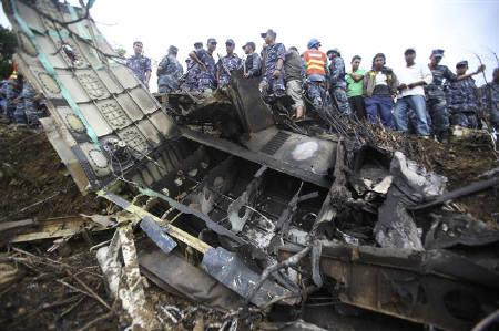 Nepalese police personnel are seen at the crash site of Buddha Air plane in Lalitpur September 25, 2011. REUTERS/Navesh Chitrakar
