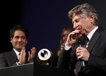 <p>Director Roman Polanski reacts next to Festival Directors Karl Spoerri (L) and Nadia Schildknecht (C) after receiving his lifetime achievement award at the Zurich Film Festival, September 27, 2011. REUTERS/Christian Hartmann</p>