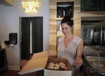 <p>Co-owner Nancy Truman prepares a box of donuts for a customer at Fonuts bakery, which offers unfried, gluten-free and vegan donuts, in Los Angeles, California September 19, 2011. REUTERS/Lucy Nicholson</p>
