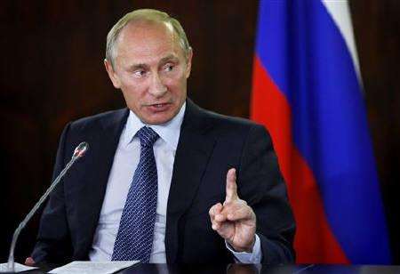 Russia's Prime Minister Vladimir Putin gestures while speaking at a meeting with activists of the All-Russian People's Front in Moscow September 21, 2011. REUTERS/Alexander Zemlianichenko