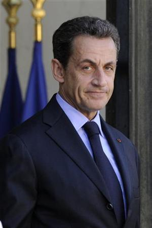 France's President Nicolas Sarkozy waits for a guest on the steps of the Elysee Palace in Paris September 30, 2011. REUTERS/Gonzalo Fuentes