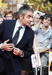 <p>Actor Rowan Atkinson arrives for the UK premiere of Johnny English Reborn, at the Empire Leicester Square in central London October 2, 2011. REUTERS/Olivia Harris</p>