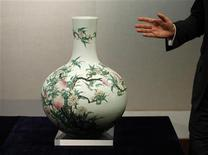 """<p>A fine and rare famille-rose """"peach"""" vase, Tianqiuping, with a seal mark and period of Qianlong, which is estimated to fetch 10.3 to 15.4 million dollars, is shown during a Sotheby's preview in Hong Kong September 7, 2011. REUTERS/Bobby Yip</p>"""