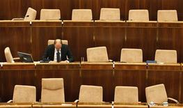 <p>Chairman of Freedom and Solidarity party Richard Sulik attends the Slovak Parliament session on the vote on the euro zone rescue fund tied with Slovak government confidence vote in Bratislava, October 11, 2011. REUTERS/Petr Josek</p>