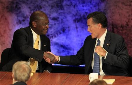 Republican presidential hopefuls (L-R) businessman Herman Cain and former Massachusetts Governor Mitt Romney shake hands at the conclusion of the Republican presidential debate at Dartmouth College in Hanover, New Hampshire October 11, 2011. REUTERS/Adam Hunger
