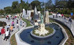 <p>Visitors walk past the Statue of Liberty and part of the New York skyline, constructed out of lego bricks, at Miniland at Legoland Florida during its grand opening celebration in Winter Haven, Florida October 14, 2011. REUTERS/Pierre DuCharme</p>
