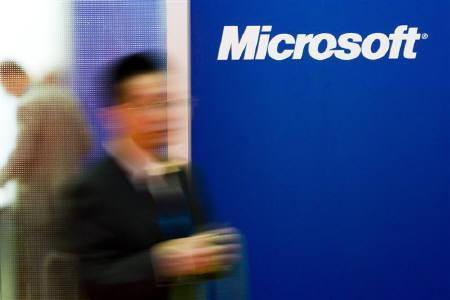 A man passes by the Microsoft booth at the International Telecommunication Union (ITU) Telecom World 2009 exhibition in Geneva October 5, 2009. REUTERS/Valentin Flauraud/Files