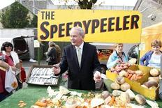 <p>Irish Presidential candidate Martin McGuinness peels vegetables during a visit to Ballinasloe Horse fair as he continues cavassing for votes ahead of the 27th October Polling day October 8, 2011. REUTERS/Cathal McNaughton</p>