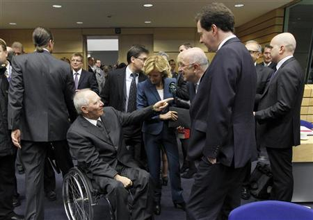 (From L to R) Germany's Finance Minister Wolfgang Schaeuble, Spain's Economy Minister Elena Salgado, European Competition Commissioner Joaquin Almunia and Britain's Chancellor of the Exchequer George Osborne arrive at an EU finance ministers meeting in Brussels October 22, 2011. The Eurogroup of euro zone finance ministers has approved the payment of the next tranche of 8 billion euros ($11 billion) under Greece's EU/IMF bailout programme -- pending approval from the International Monetary Fund, the ministers said in a statement on Friday. REUTERS/Thierry Roge (BELGIUM - Tags: POLITICS BUSINESS)