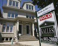 <p>A real estate sign is seen on front of a house in Toronto June 19, 2009. REUTERS/Chris Roussakis</p>
