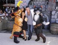 "<p>Cast members Antonio Banderas (R) and Salma Hayek (L) pose with characters at the premiere of the animated film ""Puss In Boots"" in Los Angeles October 23, 2011. REUTERS/Phil McCarten</p>"