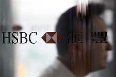 <p>A man walks past the HSBC logo at the bank's headquarters in Hong Kong September 8, 2011. REUTERS/Tyrone Siu</p>