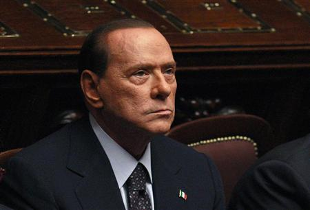 Italian Prime Minister Silvio Berlusconi looks on during a finance vote at the parliament in Rome November 8, 2011. Berlusconi, under massive pressure to resign, faces a crucial vote on public finances in parliament on Tuesday which could sink his government if enough party rebels desert him. Berlusconi has denied reports that his resignation is imminent as he struggles to hold his centre-right coalition together, but the increased political uncertainty in Italy has added to turmoil in Europe, hitting global markets on Monday. REUTERS/Tony Gentile (ITALY - Tags: POLITICS BUSINESS)