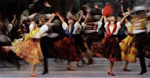 "<p>Dancers from the Mariinsky Ballet of St Petersburg perform during a dress rehearsal of the ballet ""Don Quixote"" at the Esplanade theatre in Singapore September 16, 2011. REUTERS/Tim Chong</p>"