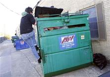 <p>Jeff Ferrell, a professor of sociology at Texas Christian University, climbs atop a dumpster in Fort Worth, Texas November 30, 2011. Ferrell routinely sifts through dumpsters of area businesses near his home, scrounging for recyclable and usable items which have been discarded by others. Picture taken November 30, 2011. REUTERS/Mike Stone</p>
