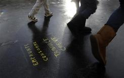 <p>People walk on a graffiti message written on the pavement next to the former Bourse (Stock Exchange) in Paris December 7, 2011. REUTERS/Gonzalo Fuentes</p>
