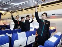 <p>PC Air transsexual flight attendants (L to R): Phuntakarn Sringern, 24, Nathatai Sukkaset, 26, Chayathisa Nakmai, 24, and Dissanai Chitpraphachin, 24, pose for photographers in a PC Air aircraft at Bangkok's Suvarnabhumi International Airport December 15, 2011. REUTERS/Chaiwat Subprasom</p>
