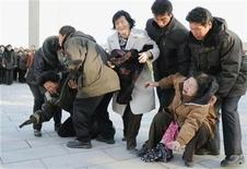<p>Pyongyang residents react as they mourn the death of North Korean leader Kim Jong-il in Pyongyang, in this photo taken by Kyodo on December 19, 2011. REUTERS/Kyodo</p>