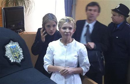 Former Ukrainian Prime Minister Yulia Tymoshenko (C) stands a during a court session in Kiev September 30, 2011. The trial of Ukraine's former prime minister Tymoshenko, charged with abuse of office in relation to a 2009 gas deal with Russia, was adjourned on Friday until October 11 at the earliest. REUTERS/Alexander Prokopenko/Yulia Tymoshenko Press Service/Handout
