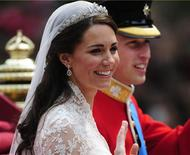 <p>Britain's Prince William and Catherine, Duchess of Cambridge travel to Buckingham Palace in the 1902 State Landau, along the Procession Route, after their wedding in Westminster Abbey, in central London April 29, 2011. REUTERS/Kieran Doherty</p>