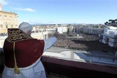 <p>Pope Benedict XVI delivers the Urbi et Orbi (to the city and the world) Christmas Day message from the central balcony of Saint Peter's Square at the Vatican December 25, 2011. REUTERS/Osservatore Romano</p>