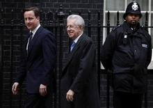 <p>Britain's Prime Minister David Cameron (L) welcomes his Italian counterpart Mario Monti to 10 Downing Street in London January 18, 2012. REUTERS/Andrew Winning</p>