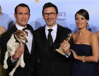 """<p>Jean Dujardin (L), winner for best performance by an actor in a motion picture - comedy or musical, director Michel Hazanavicius and actress Berenice Bejo, pose backstage with Uggie the dog after """"The Artist"""" won the award for best comedy or musical motion picture at the 69th annual Golden Globe Awards in Beverly Hills, California, January 15, 2012. REUTERS/Lucy Nicholson</p>"""
