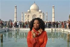 <p>Entertainment host Oprah Winfrey poses for pictures in front of the historic Taj Mahal during her visit to the northern Indian city of Agra January 19, 2012. REUTERS/Brijesh Singh</p>