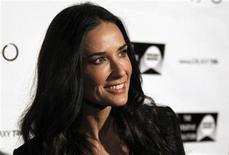 <p>Actress Demi Moore poses as she arrives at The Creative Coalition dinner during the Sundance Film Festival in Park City, Utah January 24, 2011. REUTERS/Mario Anzuoni</p>