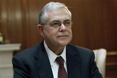 <p>Greek Prime Minister Lucas Papademos is seen in his office during a meeting with Greek political leaders in Athens January 19, 2012. REUTERS/Yiorgos Karahalis</p>