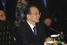<p>Chinese Premier Wen Jiabao attends the ASEAN-China Commemorative Summit on the sidelines of the ASEAN and Related Summits in Nusa Dua on the Indonesian island of Bali November 18, 2011. REUTERS/Sonny Tumbelaka/Pool</p>