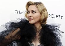 """<p>Madonna poses for photographers as she arrives for the premiere of the film """"W.E."""" which she directed, at the Ziegfeld Theater in New York City, January 23, 2012. REUTERS/Mike Segar</p>"""