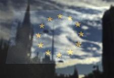 <p>The European Union flag is pictured in a window reflecting a street in London in this October 26, 2011 file photo. REUTERS/Luke MacGregor</p>