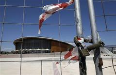 <p>The Olympic Taekwondo stadium is seen behind a fence at Faliro complex in Athens, in this file picture taken May 17 2011. REUTERS/John Kolesidis/Files</p>