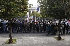 <p>Demonstrators from the communist-affiliated trade union PAME protest outside the Greek Prime Minister's office in Athens February 4, 2012. REUTERS/Yiorgos Karahalis</p>