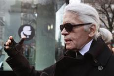 <p>German designer Karl Lagerfeld attends the launching of online web purchasing of the K by Karl Lagerfeld fashion line in Paris January 25, 2012. REUTERS/Pascal Rossignol</p>