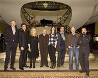 <p>Members of the jury (L to R) Dutch photographer, designer and filmmaker Anton Corbijn U.S. acctor Jake Gyllenhaal, German actress and singer Barbara Sukowa, british film director and jury president Mike Leigh, French-British actress Charlotte Gainsbourg, French director and writer Francois Ozon, Algerian author Boualem Sansal and Iranian director and writer Asghar Farhadi pose during a photocall prior to the upcoming 62nd Berlinale International Film Festival in Berlin February 8, 2012. REUTERS/Morris Mac Matzen</p>