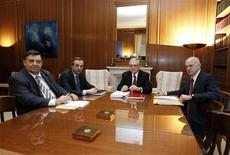 <p>Far-right leader George Karatzaferis (L), conservative party leader Antonis Samaras (2nd L), Prime Minister Lucas Papademos (C) and Socialist leader George Papandreou meet at the Prime Minister's office in Athens, February 8, 2012. REUTERS/Yiorgos Karahalis</p>