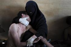 <p>Samuel Aranda of Spain, a photographer working for The New York Times, has won the World Press Photo of the Year 2011 with this picture of a woman holding a wounded relative during protests against president Saleh in Sanaa, Yemen October 15, 2011. REUTERS/Samuel Aranda/Corbis/The New York Times/Handout</p>