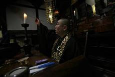 <p>Koyu Abe, a Zen priest, lights a candle at the main hall of his Joenji temple in Fukushima, northern Japan February 3, 2012. REUTERS/Yuriko Nakao</p>
