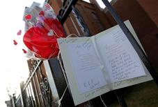 <p>Flowers and a card are seen left as a memorial to deceased singer Whitney Houston, in front of the New Hope Baptist Church, where she sang in the choir, in Newark, New Jersey, February 12, 2012. REUTERS/Adam Hunger</p>