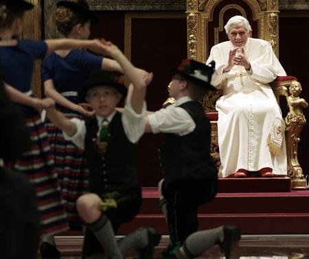 Children dressed in traditional Bavarian costumes dance for Pope Benedict XVI during the Pontiff's 85th birthday celebrations in the Clementine Hall at the Vatican April 16, 2012. REUTERS/Gregorio Borgia/Pool